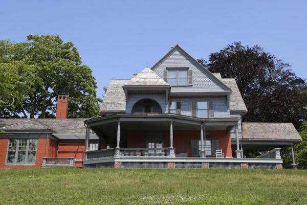 """In this June 9, 2015, photo, Sagamore Hill, Theodore Roosevelt's  """"Summer White House,""""  is shown at Sagamore Hill National Historic Site in Oyster Bay, N.Y. The three-story, 28-room mansion, named by Roosevelt after the Indian chief Sagamore Mohannis, will reopen July 12, 2015,  after a four-year, $10 million renovation by the National Park Service.  (AP Photo/Kathy Willens)"""