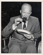 NMAH Archives CenterGood Humor Ice Cream Collection0451Box 1Folder 7Photograph of President Dwight D. Eisenhower eating a Good Humor Bar, taken by International News Photos of New York.