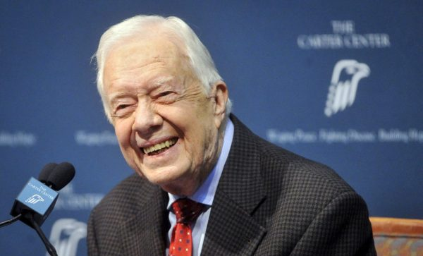 Former U.S. President Jimmy Carter takes questions from the media during a news conference about his recent cancer diagnosis and treatment plans, at the Carter Center in Atlanta